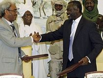 Sudanese rebel Justice and Equality Movement (JEM) representative Jibril Ibrahim shakes hands with Amin Hassan Omar