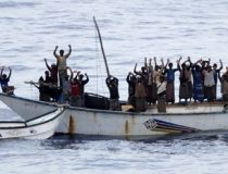 NATO handout photo showing hostages and pirates standing with hands up before intervention of Dutch NATO soldiers off Somalia's coast