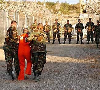 prisoner being led by US soldiers