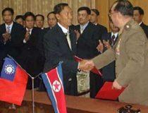 Burma and North Korean officials shake hands