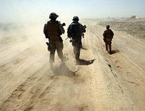 U.S. Marines walk around a base in Helmand province