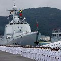 Navy soldiers line by Chinese naval ship