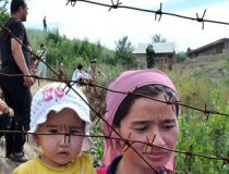 An ethnic Uzbek mother holds her daughte