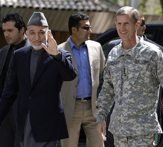 Afghanistan's President Karzai and US And NATO commander General McChrystal arrive at the ISAF headquarter in Kabul