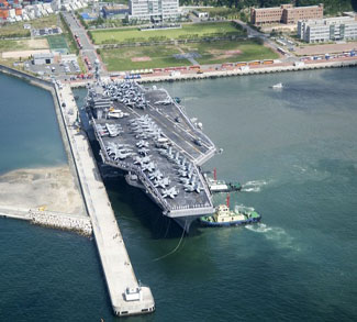 The USS George Washington aircraft carrier moors in Busan