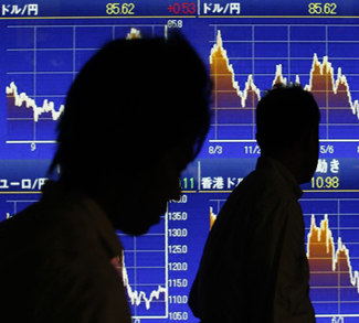 People walk past a board showing graphs of Japanese Yen's exchange rate against U.S. dollar and Euro outside a brokerage in Tokyo