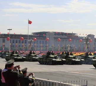 File photo of tanks rumbling pass Tiananmen Square in a parade to mark the 60th anniversary of the founding of the People's Republic of China in Beijing