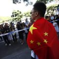 A Chinese man wraps in a Chinese flag during an anti-Japan protest over disputed islands called Diaoyu in China and Senkaku in Japan, near the Japanese consulate in Shanghai