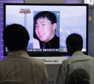 South Koreans watch a television news report showing the person believed to be Kim Jong-un, the youngest son of North Korean leader Kim Jong-il, at the Seoul railway station