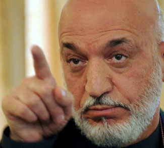 Afghan President Hamid Karzai speaks dur