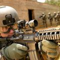 US soldier lines up rifle