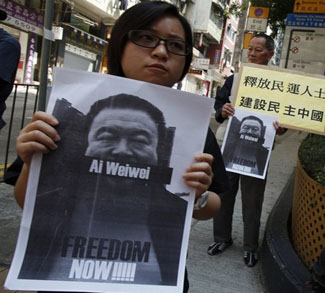 Pro-democracy protesters carry portraits of detained Chinese artist Ai Weiwei in Hong Kong