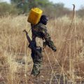 A South Sudan's army, or the  SPLA, soldier carries water to his position on the frontline in Panakuach