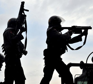 Indonesian policemen prepare to fire tea