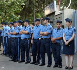 Georgian police officers block the entra