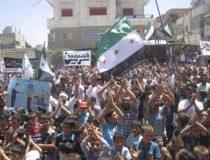 Demonstrators protest against Syria's President Bashar al-Assad after Friday prayers in Sermeen