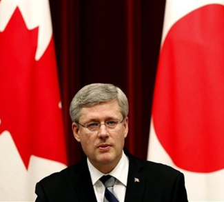 Harper Between Canadian And Japanese Flag