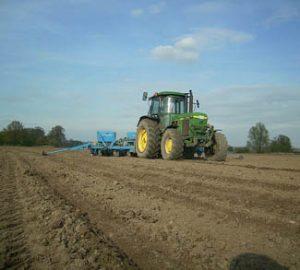 John Deer tractor harvesting crops