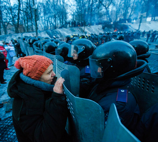 Ukraine protesters up against riot police