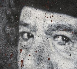 Portait wall-painted of Portait wall-painted of at Muammar al Gaddafi