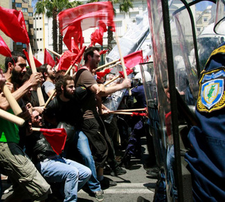 Protesters clash with policemen during riots at a May Day rally in Athens, cc Flickr Joanna