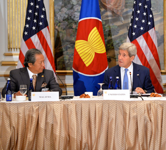 Flanked by Malaysian Foreign Minister Anifah Aman and Assistant Secretary of State for East Asian and Pacific Affairs Daniel Russel, U.S. Secretary of State John Kerry participates in the U.S.-ASEAN meeting on the sidelines of the 70th Regular Session of the UN General Assembly in New York, New York, on September 30, 2015. [State Department photo/ Public Domain]