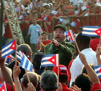 fidel2005, cc Volker Hüttig Volker_Huettig@yahoo.de, User Vandrad on de.wikipedia, modified, https://commons.wikimedia.org/wiki/File:Fidel_Castro_1._Mai_2005_bei_Kundgebung.jpg