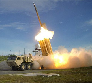a US THAAD launcher, public domain, US Army - https://commons.wikimedia.org/wiki/File:The_first_of_two_Terminal_High_Altitude_Area_Defense_(THAAD)_interceptors_is_launched_during_a_successful_intercept_test_-_US_Army.jpg