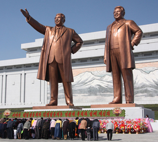 kimstatues, J.A. de Roo, Wiki Commons, https://commons.wikimedia.org/wiki/File:The_statues_of_Kim_Il_Sung_and_Kim_Jong_Il_on_Mansu_Hill_in_Pyongyang_(april_2012).jpg