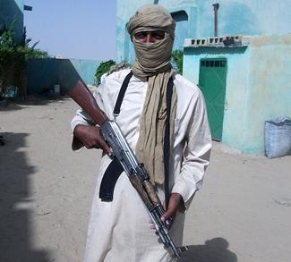 credit: Magharebia, modified, https://commons.wikimedia.org/wiki/File:Al-Qaida_cr%C3%A9e_une_brigade_dirig%C3%A9e_par_des_Touaregs_(8246938011).jpg, https://creativecommons.org/licenses/by/2.0/deed.en