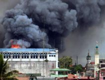 Bombing of Marawi City, cc Wikicommons Mark Jhomel, modified, https://commons.wikimedia.org/wiki/File:Bombing_on_Marawi_City.jpg