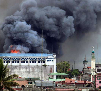 Bombing of Marawi City, cc Wikicommons Mark Jhomel, modified, https://commons.wikimedia.org/wiki/File:Bombing_on_Marawi_City.jpg