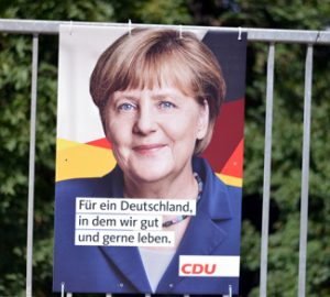 MerkelPoster, cc Flickr opposition24.de, modified, https://creativecommons.org/licenses/by/2.0/
