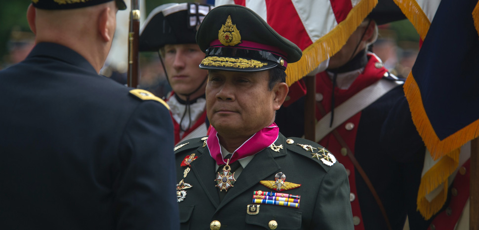 Commander-in-Chief of the Royal Thai Army Gen. Prayuth Chan-ocha, center, receives the Legion of Merit from Chief of Staff of the U.S. Army Gen. Ray Odierno during an Army full honors ceremony at Joint Base Myer-Henderson Hall in Arlington, Va., June 6, 2013. (U.S. Army photo by Staff Sgt. Teddy Wade/Released)