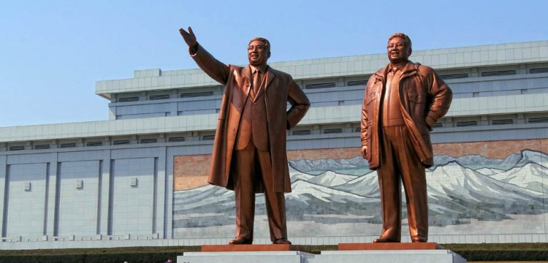 cc Bjørn Christian Tørrissen , modified, https://en.wikipedia.org/wiki/North_Korean_cult_of_personality#/media/File:Mansudae-Monument-Bow-2014.jpg