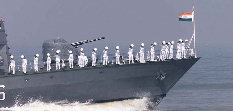 cc Indian Navy, modified, https://commons.wikimedia.org/wiki/File:Indian_Navy_personnel_salute_from_a_naval_ship.jpg