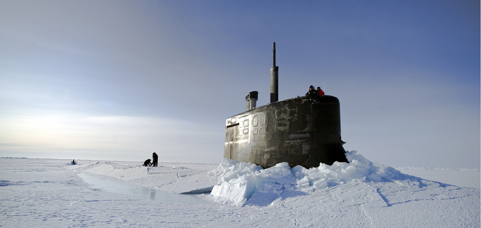 ARCTIC OCEAN (March 19, 2011) Sailors and members of the Applied Physics Laboratory Ice Station clear ice from the hatch of the Seawolf-class submarine USS Connecticut (SSN 22) as it surfaces above the ice during ICEX 2011. (U.S. Navy photo by Mass Communication Specialist 2nd Class Kevin S. O'Brien/Released)