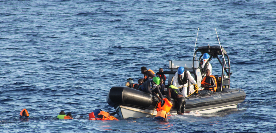 An Irish boat rescues migrants off the coast of Tripoli; cc Flickr Irish Defence Forces, modified, https://creativecommons.org/licenses/by/2.0/