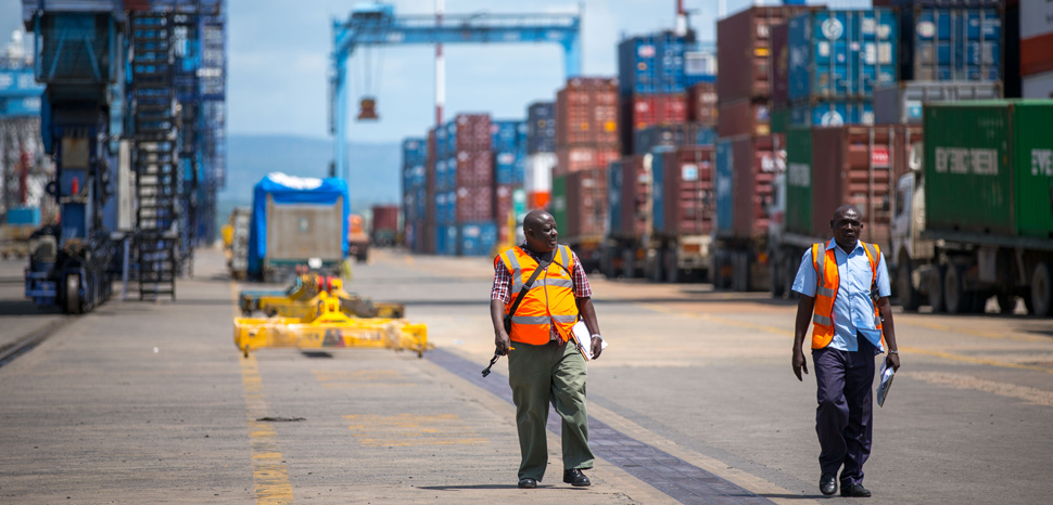 KENYA, Mombasa: Photograph taken by the Kenyan Ministry of East African Affairs, Commerce and Tourism (MEAACT) 31 July shows officials walking inside Mombasa Port on Kenya's Indian Ocean coast. MANDATORY CREDIT: MEAACT PHOTO / STUART PRICE. , modified