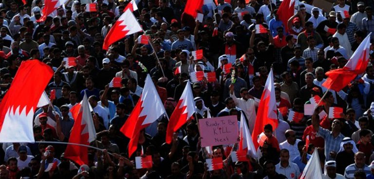 Bahrain Arab Spring, cc Lewa'a Alnasr, modified, https://en.wikipedia.org/wiki/Arab_Spring#/media/File:Hundreds_of_thousands_of_Bahrainis_taking_part_in_march_of_loyalty_to_martyrs.jpg