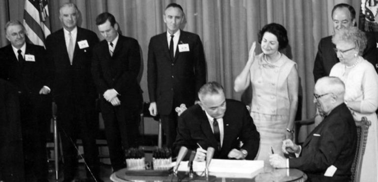 President Johnson signs the Great Society bill, US government, public domain https://commons.wikimedia.org/wiki/File:President_Lyndon_B._Johnson_signs_Medicare_Bill_at_the_Harry_S._Truman_Library,_1965.jpg