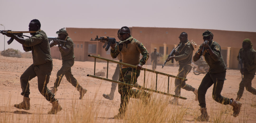 Forces Armees Nigeriennes soldiers advane on a notional enemy position in a training mission during Exercise Flintlock 2018 at Agadez, Niger, April 17, 2018. Flintlock is an annual, African-led, integrated military and law enforcement exercise that has strengthened key partner nation forces throughout North and West Africa as well as western Special Operations Forces since 2005. (U.S. Army photo by Sgt. 1st Class Mary S. Katzenberger, 3rd Special Forces Group (Airborne)/Released)