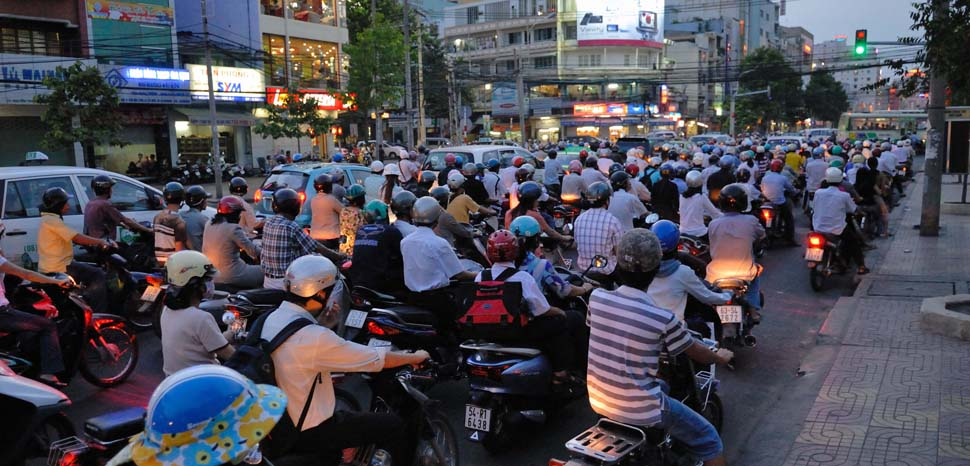 Rush hour traffic in Ho Chi Minh City, cc Flickr M M, modified, https://creativecommons.org/licenses/by-sa/2.0/