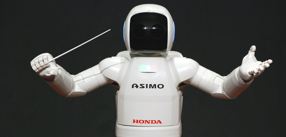 ASIMO conducting post, CC Vanillase, modified, https://commons.wikimedia.org/wiki/File:ASIMO_Conducting_Pose_on_4.14.2008.jpg