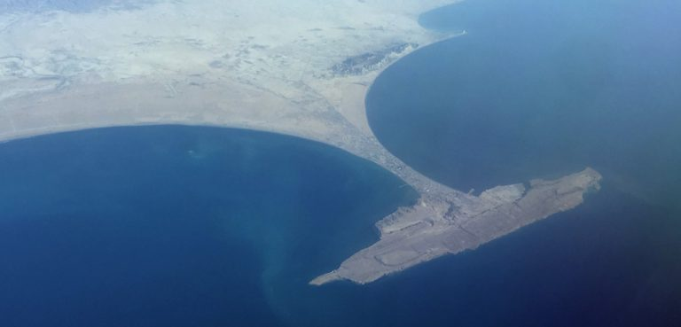 GwadarPort, cc Bjoertvedt, modified, Wiki Commons, https://commons.wikimedia.org/wiki/File:Pakistan_Balochistan_province_-_Gwadar_IMG_7931.jpg