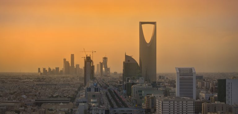 Riyadh Skyline, cc B.alotaby, modified, https://commons.wikimedia.org/wiki/File:Riyadh_Skyline_showing_the_King_Abdullah_Financial_District_(KAFD)_and_the_famous_Kingdom_Tower_.jpg