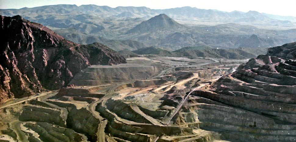 A strip mine near Globe Arizona, circa 1990; cc Flickr Phillip Capper, modified, https://creativecommons.org/licenses/by/2.0/