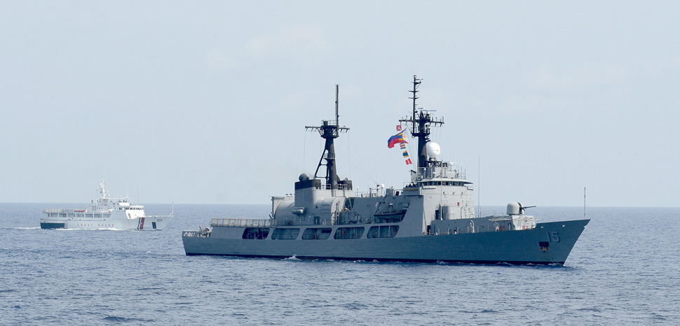 130629-N-YU572-272 PHILIPPINE SEA (June 29, 2013) - The Philippine Coast Guard vessel Edsa (SARV 002), left, and the Philippine Navy frigate Gregorio Del Pilar (PF 15) steam in formation during Cooperation Afloat Readiness and Training (CARAT) Philippines 2013. More than 600 Sailors and Marines are participating in CARAT Philippines 2013. U.S. Navy units participating in CARAT Philippines include the Fitzgerald with embarked Destroyer Squadron (DESRON) 7 staff, a U.S. Marine Corps landing force, and the diving and salvage vessels USNS Safeguard (T-ARS 50) and USNS Salvor (T-ARS 52) with embarked Mobile Diving and Salvage Unit (MDSU) 1. CARAT is a series of bilateral military exercises between the U.S. Navy and the armed forces of Bangladesh, Brunei, Cambodia, Indonesia, Malaysia, the Philippines, Singapore, Thailand and Timor Leste. (U.S. Navy photo by Mass Communication Specialist 1st Class Jay C. Pugh) (RELEASED), cc Naval Surface Warriors, Flickr, modified, https://creativecommons.org/licenses/by-sa/2.0/