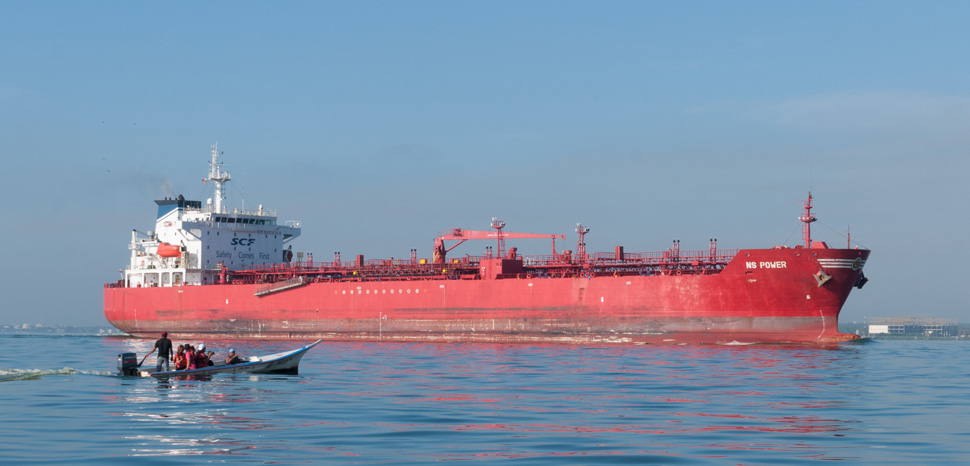 A Russian Tanker (not the actual one seized by Ukraine), author 'The Photographer,' modified, https://commons.wikimedia.org/wiki/File:Oil_tanker_crossing_the_bridge_over_Lake_Maracaibo.jpg