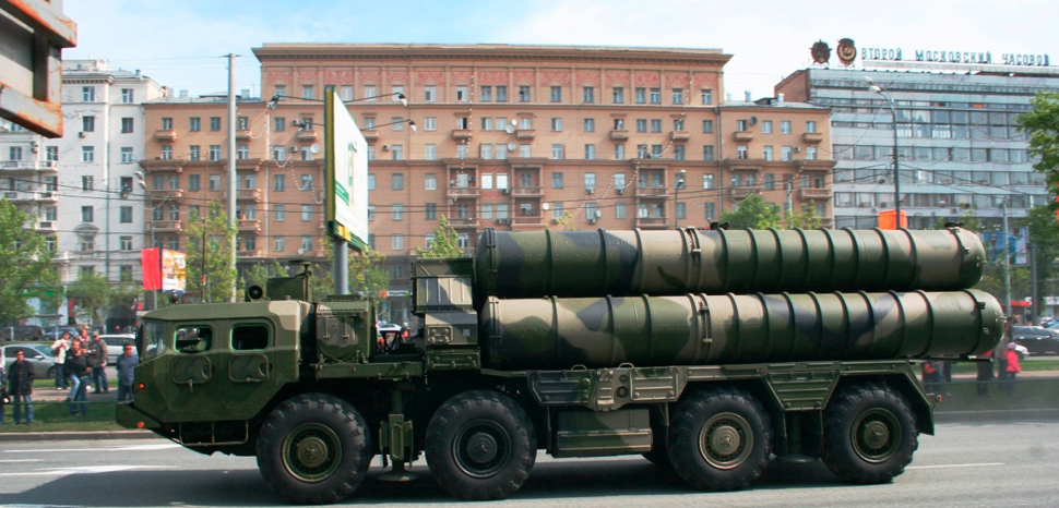 An S-300 anti-aircraft system missile launcher in a Russian military parade. , modified, cc SLonoed, https://commons.wikimedia.org/wiki/File:Side_view_of_a_S-300_launcher.JPG
